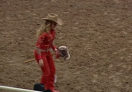 Potential Rodeo Queen Riding A Stick Horse