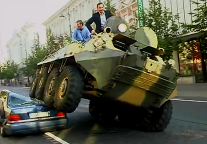 Car Being Crushed By A Tank