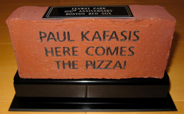 The final brick, reading Paul Kafasis - Here Comes The Pizza!