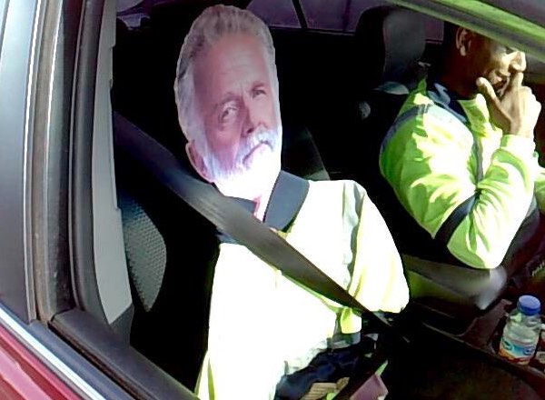 Man with cardboard cutout driving in HOV lane