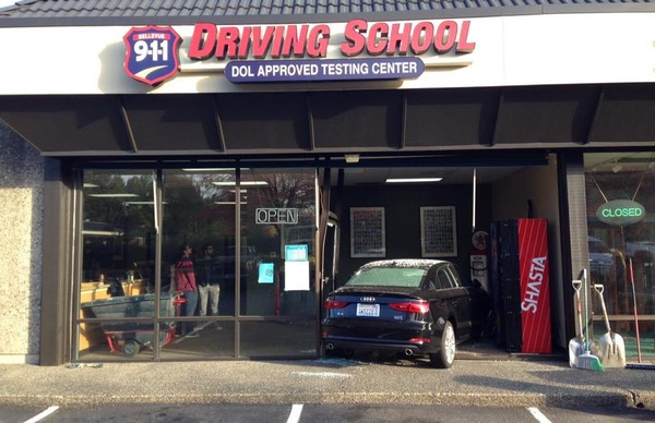 A car has been driven through the front wall of the 9-1-1 Driving School.