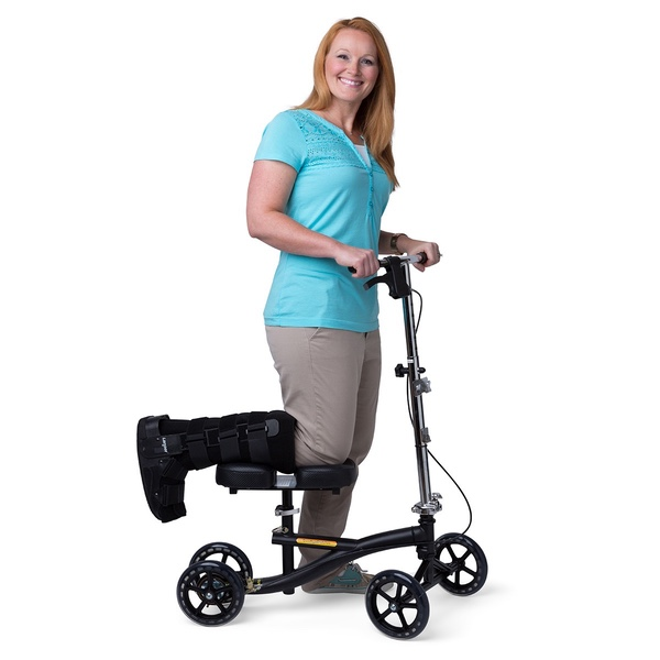 A woman using a knee scooter