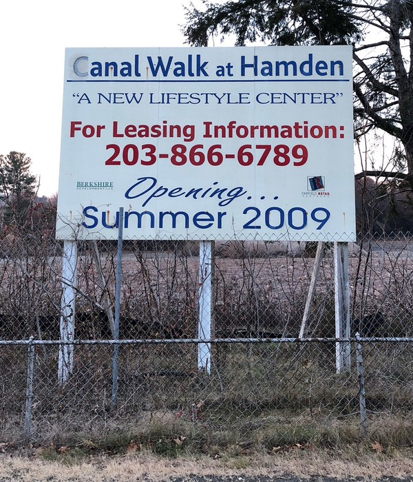 A sign advertising Canal Walk at Hamden, Opening Summer 2009