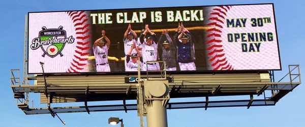 Billboard for a local baseball team announcing 'The clap is back!'
