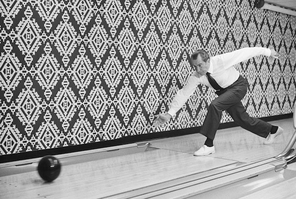 Richard M. Nixon bowling, and committing a foul by stepping over the boundary line.