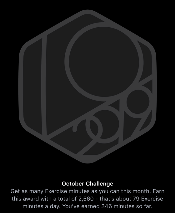Challenge stating 'Earn this award with 2560 Exercise minutes - that's about 79 minutes a day'.