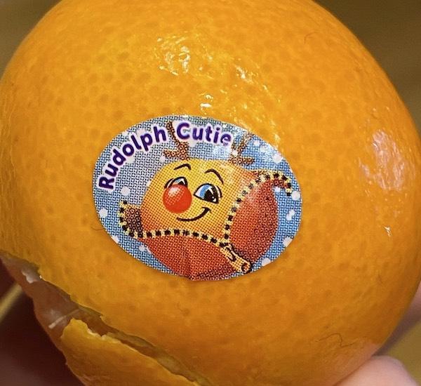 A sticker which reads 'Rudolph Cutie'