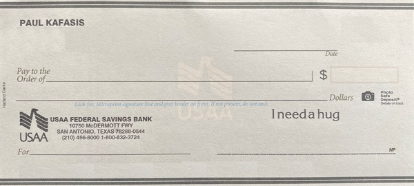 A check that says 'I need a hug'.
