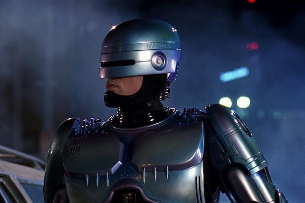 A still from the movie Robocop, a satirical look at a dystopian world with private police forces.