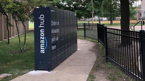 A very large Amazon locker, blocking much of a sidewalk.