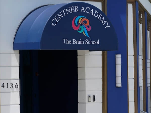 """An awning reading """"The Centner Academy - The Brain School"""